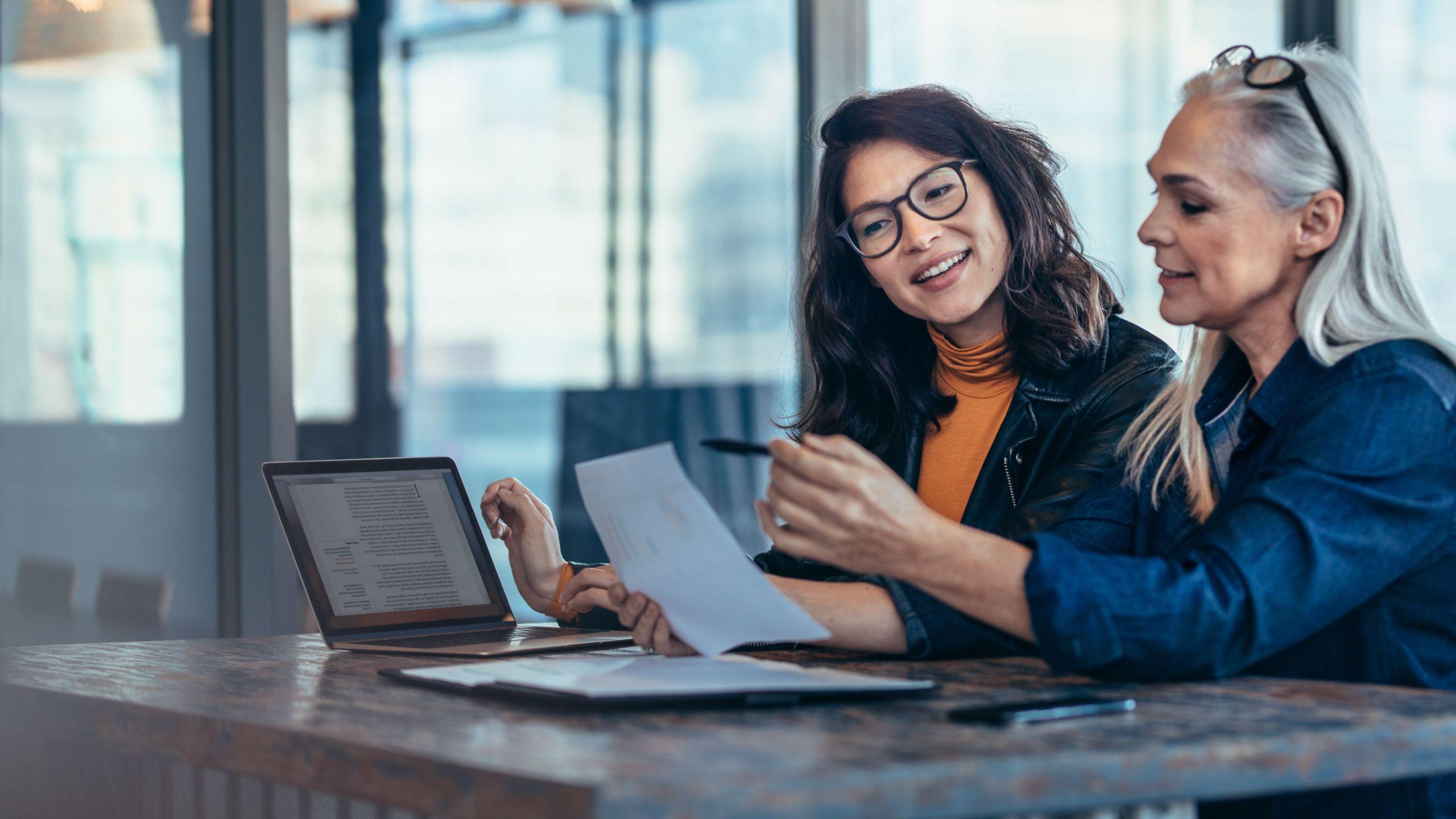 women analyzing report